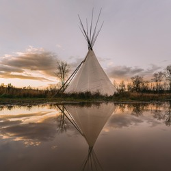 Teepee Tipi at sunset with dramatic sky
