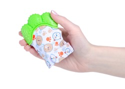 Teether glove for babies in hand on white background isolation
