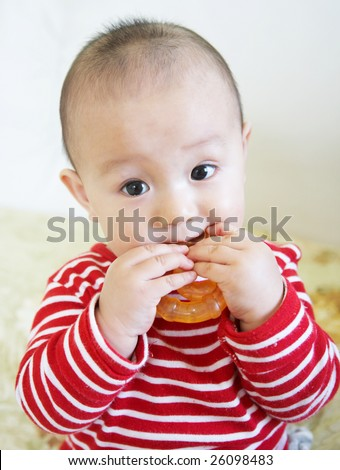 Teething baby bite