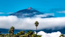 Teide, Tenerife, Spain - The Pico del Teide (Teide), at 3718 m, is the highest peak on the island of Tenerife. In the morning of a day, with blue skies and rising clouds in October.