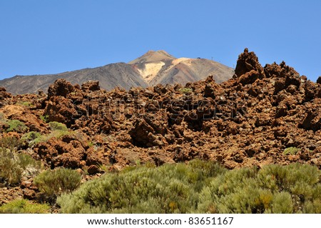 Teide volcano (Pico del Teide) in the background with blocks of lava at Tenerife in the Spanish Canary Islands