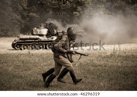 TEKOV, SLOVAKIA - JULY 7: Soviet soldiers attacking - reenactment of World War II fights near river Hron on July 7, 2009 in Tekov, Slovakia.