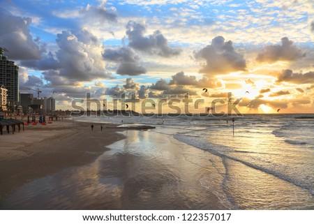 Tel-Aviv beach sunset view and kite surfing (Mediterranean sea. Israel)