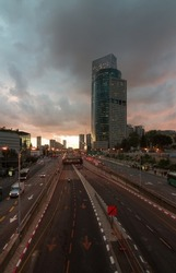 Tel Aviv city sunset cloudy view. Modern skyscrapers and automobile roads