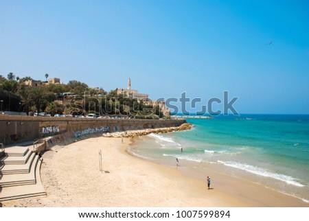 TEL AVIV, ISRAEL - AUGUST 18, 2010: Horizontal picture of beautiful Gordon beach in a sunny day of Tel Aviv Israel