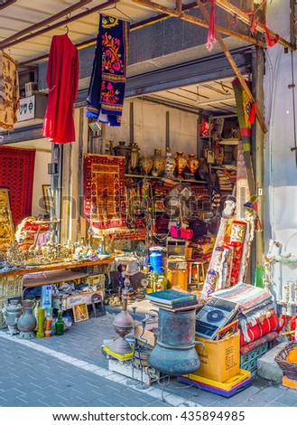 TEL AVIV, ISRAEL - FEBRUARY 25, 2016: The market stall offers different goods, from the colorful carpets to the cookware, on February 25 in  Tel Aviv. #435894985