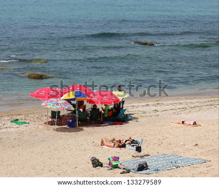 Tel aviv israel march 16 unknown people on the beach for Best beach vacations in march