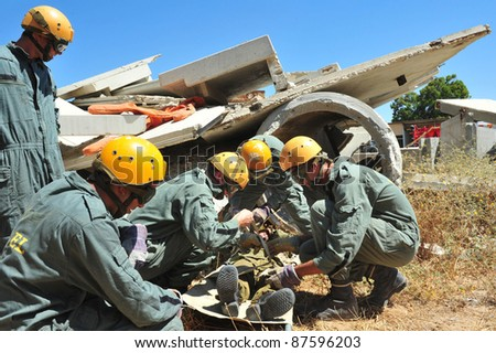 TEL AVIV, ISRAEL - NOVEMBER 11:  Search and rescue forces search through a fallen building for survivors during a rescue exercise on November 11, 2010 in Tel Aviv, Israel.