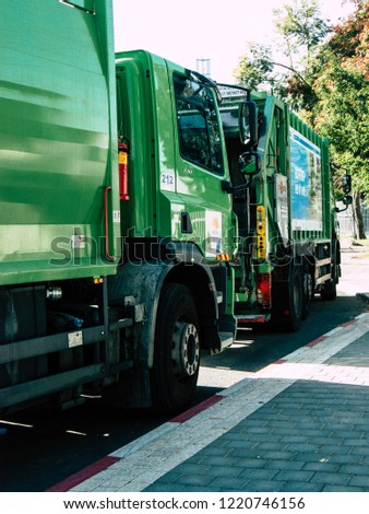Tel Aviv Israel October 25, 2018  View of a green garbage truck parked in the streets of Tel Aviv in the afternoon #1220746156