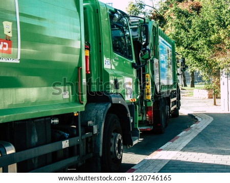 Tel Aviv Israel October 25, 2018  View of a green garbage truck parked in the streets of Tel Aviv in the afternoon #1220746165