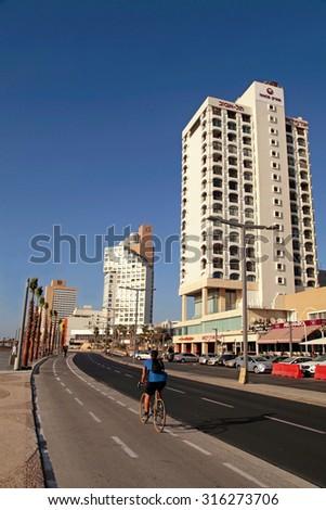 TEL AVIV, ISRAEL - SEPTEMBER 1, 2015: View of Tel Aviv beach promenade with modern hotels and buildings in Tel Aviv, Israel