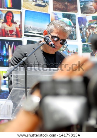 TEL AVIV - JUNE 7:Israeli Minister of Finance and chairman of the Yesh Atid Party Yair Lapid tries to speech during the opening of the annual Gay Pride Parade June 7, 2013 in Tel Aviv, Israel.