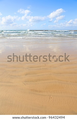 Tel-Aviv sandy beach. Ebb. Mediterranean sea.Tel-Aviv. Israel - stock photo