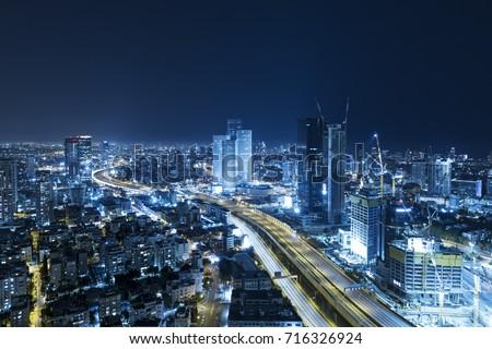 Tel Aviv Skyline At Night, Skyscraper and Ayalon Freeway - Toned In Blue Stock fotó ©