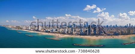 Tel Aviv skyline off the shore of the Mediterranean sea - Panoramic aerial image Stock fotó ©