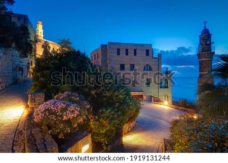 Tel Aviv-Yafo night view. Al bahar Mosque, St. Peter's Church Stok fotoğraf ©