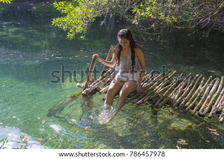 TELCHAC PUERTO, YUCATAN - NOVEMBER 01 2015: Beautiful local girl. Posing for a photograph . Photographed in Cenote Dzopito, in Telchac Puerto on NOVEMBER 01 2015. #786457978