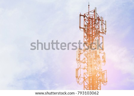 Telecom base station tower with sky background