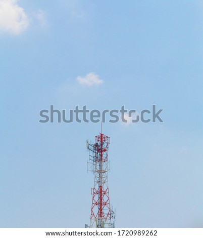 Telecom concept. Telecommunication tower. Mobile phone tower silhouette with blue sky. Mobile telecommunication tower or cell tower. Antennae and electronic communication equipment. Phone antenna.