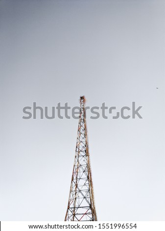 Telecom tower photographed with a minimal sky.