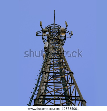 telecom tower; telecommunications/cellphone mast against clear blue sky; good copy space