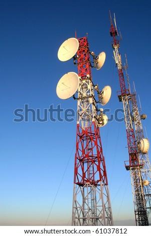 Telecommunication Antenna on Background of Blue Sky.