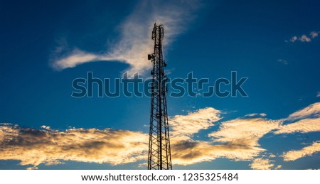 Telecommunication cellular tower in sunset sky. #1235325484