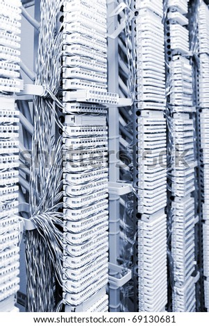 Telecommunication equipment of network cables in a datacenter.