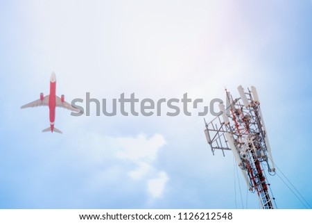 Telecommunication GSM (5G,4G) post  and plane on sky background.Concept of network connectivity and signaling around the world.Digital cellular telephone.Antenna.Communication #1126212548