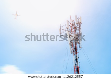 Telecommunication GSM (5G,4G) post  and plane on sky background.Concept of network connectivity and signaling around the world.Digital cellular telephone.Antenna.Communication #1126212557