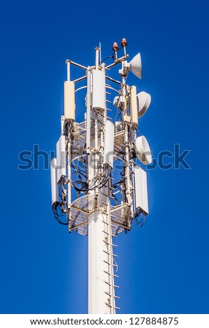 Telecommunication mast at the blue sky