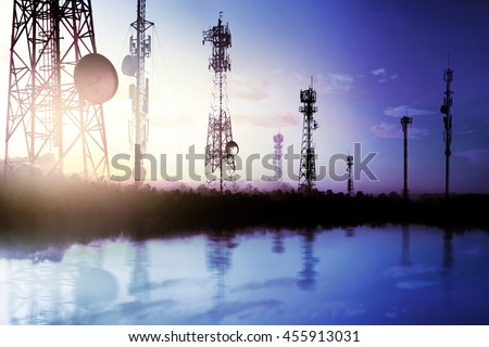 Telecommunication mast TV antennas wireless technology with sunligh sky