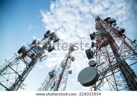 Telecommunication mast TV antennas with blue sky in the morning