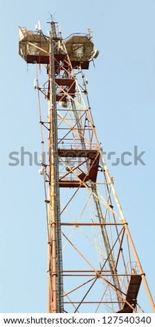 Telecommunication mast with blue sky background #127540340