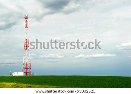 Telecommunication pillar in open field