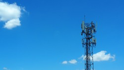 Telecommunication pole of 4G and 5G cellular against blue sky with tiny white cloud. Transceiver Station. Wireless Communication Antenna Transmitter.