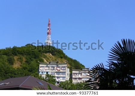 Telecommunication tower and buildings in mountains. The Black Sea coast of Caucasus