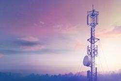 Telecommunication tower Antenna at sunset sky.