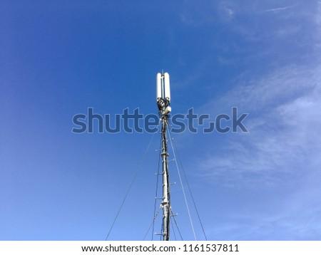 Telecommunication tower. Digital wireless communication system. Basic station mobile phone. 5G of the smart antenna of a basic radiotelephone. - Shutterstock ID 1161537811