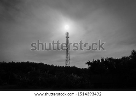 telecommunication tower in black and white tone.silhouette satellite telecom network