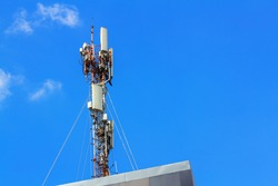 Telecommunication tower of 4G and 5G cellular. Macro Base Station. Wireless Communication Antenna Transmitter. Telecommunication tower with antennas against blue sky.