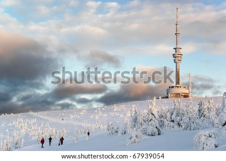 Telecommunication tower on the barren hill covered with snow, Czech Republic, Praded