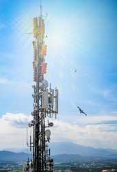 Telecommunication tower transmitting signals of cellular mobile 5g and 4g. Simulated radio waves on transmitter mast with antennas and equipment of high speed mobile network and broadband Internet.