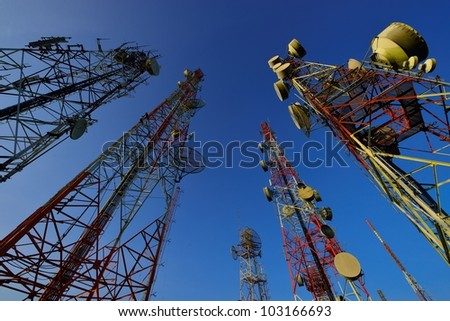 Telecommunication tower with a bit morning sunlight - stock photo