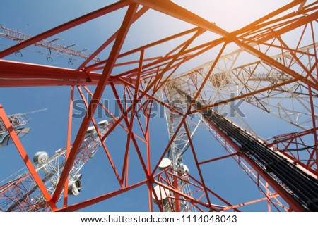 Telecommunication tower with antennas with blue sky in the morning.
