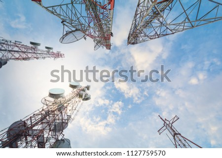 Telecommunication tower with antennas with blue sky in the morning sunlight,on the mountain.