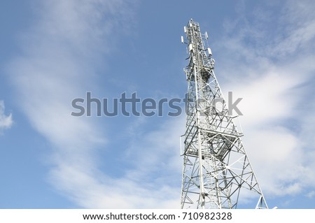 Telecommunication tower with blue and cloudy sky