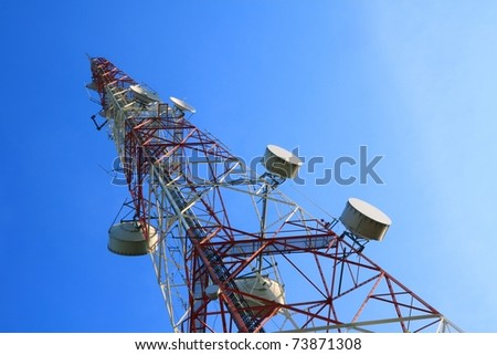 Telecommunication tower with rich blue sky - stock photo