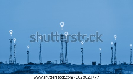 Telecommunication towers on hill with location signal sign