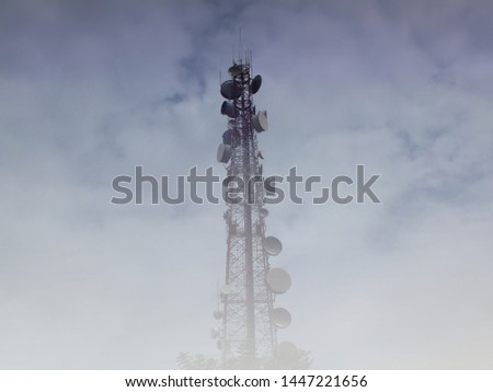 Telecommunications tower and satellite dish telecom network Covered with foggy.